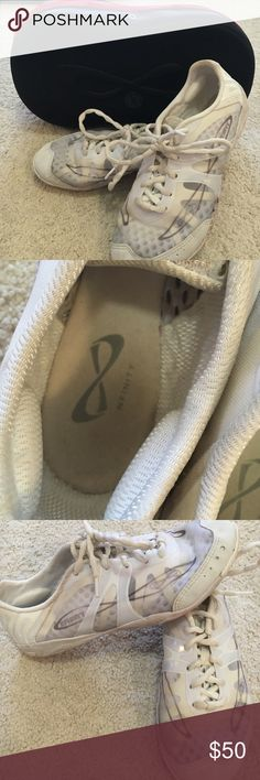 Nfinity cheer shoes with case Nfinity cheer shoes. Only worn twice. In perfect condition with no tears. They weigh 3 ounces so they're super nice to tumble in. Comes with black case! Nfinity Shoes