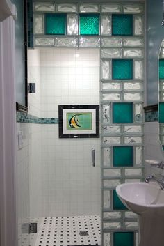 Colored glass block in a bathroom and shower remodel in San Diego California. Notice the interesting Catalina tile which was repurposed from the original bathroom. For other glass block shower ideas - innovatebuildings. Glass Bathroom, Bathroom Wall Decor, Small Bathroom, Glass Tiles, Bathroom Ideas, Glass Brick, Bathroom Remodeling, Remodeling Ideas, Bathroom Showers