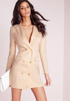 Look fierce this season in this Nude blazer dress. In a figure flattering fabric this chic nude number with long sleeves, pocket front, silk collar and gold button feature is seriously smokin'. Team with black strappy heels and matching clu...