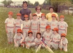 """1975. Little league. In the middle of a game, the league photographer showed up to snap our team photograph. That inning, I had been playing catcher and was wearing all of the catcher's gear– chest protector, face mask, helmut, shin guards and of course, the team cup which I wore over the uniform. I forgot to remove something before the photograph was snapped and to this day, I believe the photographer got a helluva good laugh out of it."""