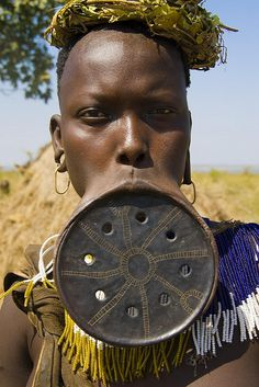 Africa |  Portrait of a Mursi woman, Ethiopia.