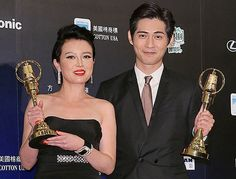 Taiwanese actress Miao Ke Li and actor Vic Chou hold up their trophies for Best Leading Actress and Best Leading Actor in Television Series awards respectively during the 48th Golden Bell Awards ceremony in Taipei, Taiwan, October 25, 2013