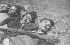 """Dead fighters from the Slovenian Brezanskoy partisan brigade. Photo taken by the Germans. KPS acronym on the rifle butt stands for """"the Communist Party of Slovenia."""" Many partisans of this particular brigade had fought on the communist side in the Spanish Civil War, hence the inscription on the rifle NO PASARAN FASISTAS -- """"FASCISTS YOU WILL NOT PASS""""."""