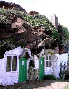 This cave house under Holy Austin Rock on the border of Staffordshire and Worcestershire, England was carved out of the sandstone Kinver Edge escarpment . British Rock Houses: preserved by the National Trust, the last rock house dwellers moved out in the Bungalows, Small Entry, Underground Homes, England, House On The Rock, Unusual Homes, Earthship, Cave Houses, Rock Houses