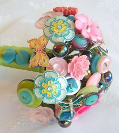 Button bouquet for teal glass vase for the nursery
