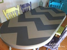 DIY chevron table. Of all the chevron table tutorials I've seen this one describes the easiest way to make the chevron lines straight and even. I would make the chevrons smaller though :)