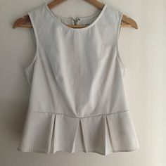 Peplum Top Bone color, peplum top. Has a leather type look to it but it's actually polyester. Size large. Has a small, barely visible, stain on the collar, as shown in the last picture. Kimchi Blue Tops Blouses