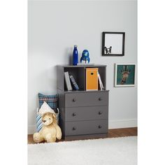 The Ameriwood Home Skyler 3 Drawer Dresser with Cubbies is just what your child needs to keep his or her room tidy. Use the spacious 3 drawers for storing folded clothes, linens or toys. The 2 open cubbies provide extra storage, but are also designed to fit non-woven fabric storage bins (sold separately). These cubbies are great for showcasing books or your child's favorite toy. The neutral gray graphite finish makes this 3 Drawer Dresser compatible with any color scheme. Ameriwood Home…