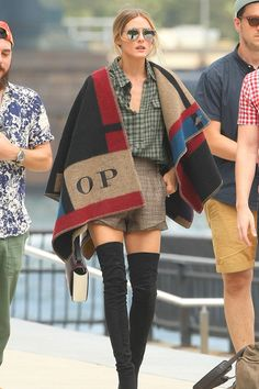 Olivia Palermo wearing a personalized Burberry Prorsum cape and Stuart Weitzman suede boots.