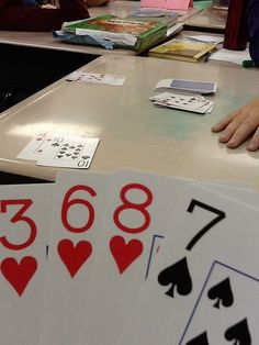 Integers card game: The red cards are negative and the black are positive. Each player starts with 6 cards, drawing one at the beginning of their turn and discarding one at the end. The goal is to play pairs that equal 6 or -6. The person playing 3 pairs first wins. The other players add the absolute value of their cards to get a score. The goal is to have the lowest score at the end of the game.