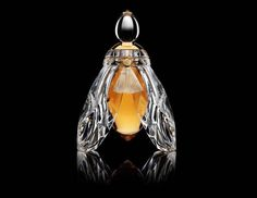 Guerlain teamed again with Baccarat to manufacture a massive flacon for the ultra-exclusive flacon of their new perfume called L'Abeille de Guerlain. Description from voguemartini.blogspot.com. I searched for this on bing.com/images
