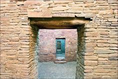 """16 x 24 photograph of ancient stone walls at the Pueblo Bonito Ruin at Chaco Canyon, New Mexico. Art décor architectural photography showing rooms connected by multiple doors. Image title: Rooms within Rooms This image is from my photography series of objects from the past. When I travel, I seek out Native American reservations and ruins. All photographs are original and photographed by artist Bob Estrin. Print details: - Unmatted photograph on paper - Image area is 16"""" x 24"""" with an..."""