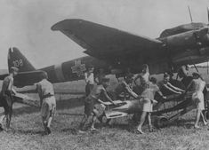 Staff prepare bomb`s - to be loaded - into Romanian / German production bomber Junkers JU 88 ( JU 88 ) - Ww2 Photos, Ww2 Planes, Ww2 Aircraft, Royal Air Force, Japan, Luftwaffe, Military History, World War Two, First World