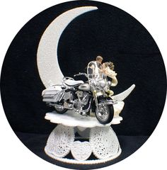 Description  Beautiful bride in gown and groom with their cool  Harley Motorcycle. I think it is a glide? Custom designed by Laceys  I use only