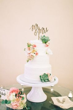 Pretty succulent topped wedding cake: http://www.stylemepretty.com/little-black-book-blog/2016/03/29/rustic-elegant-winery-wedding-filled-with-diy-details/   Photography: Aga Jones - http://agajonesphotography.com/