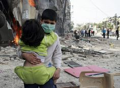 A child rescuing a child after regime's bombing of Bustan al-Qasr Syrian Children, Kindness Projects, Middle East, Blind, Horror, Language, Aleppo, Syria, Christians