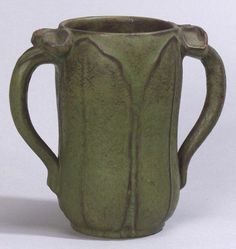 Walley Pottery vase,  Sterling, Massachusetts, c. 1905.  Two handles connected to cylindrical form with broad overlapping leaves, impressed WJW, chips, ht. 6 in.
