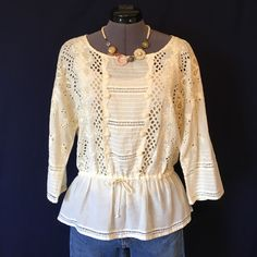 """Moulinette Soeurs """"Otsego Blouse"""" from Anthro GORGEOUS!!  """"Moulinette Soeurs' cinched-waist cotton shirt is adorned with ivory pompoms and oversized eyelets."""" -Anthro site. Drawstring tie at waist as well as a little bit of elastic. Pullover styling. Tag says size 8, but runs small. I have it shown on a size 2 dress form and it fits well as an oversized bohemian top. I think a size 4 and 6 could fit this top well also. Very see thru, I have a nude camisole underneath. Bust measured flat is…"""