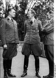 Reinhard Heydrich with Secretary Karl Hermann Frank (right) and Horst Böhme (left) in Prague, late September 1941.