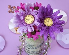 New Year's Eve Floral Centerpiece: A fun way to use clocks in your party décor is adding them to the center of flowers. This clock stamp adds a New Year's Eve twist to a pretty floral centerpiece / Friskars