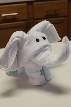 Turn Swaddling Blankets Into An Elephant. Cute to put in a basket for baby shower gift. by delores