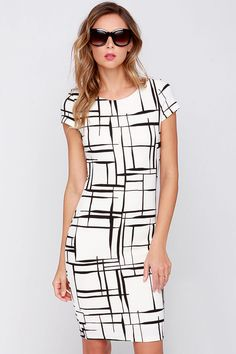 Long and Drawn Out Black and Ivory Print Midi Dress at Lulus.com! Gorgeous dress for work or church! Women's spring summer fashion clothing outfit