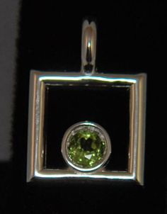 Peridot and Sterling Silver pendant From the Textures and colors collection Lannan Jewelry