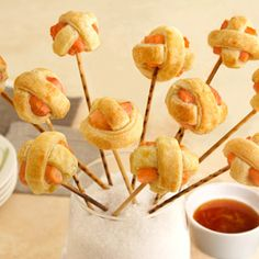 """What fun! These savory """"lollipuffs"""" feature a bite of salmon, flavored with orange marmalade, baked in a golden puff pastry and served on skewers. They're sure to be a hit at your next gathering. Comments"""