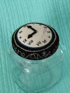 The pincushion on the top of a sewing kit By iluvzflowrs