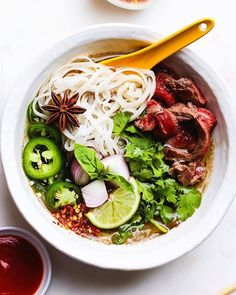 A delicious bowl of pho is even better with the flavorful heat of our #greensriracha ! Grab your #srirachagranada today from @amazon ! Link in bio. ... Credit to @lindseyeatsla crazy pho you. all my favorite things in one bowl and topped with loads of lime juice hoisen vinegar noodles & jalapeño . . . . . . . . . . . . . . .  #srirachaoneverything #srirachalover #srirachasauce #spicysauce  #eathealthybehealthy #hotsauceoneverything #hotsauces #healthysauce #phosoup #phobowl #hotsoup… Sriracha Sauce, Spicy Sauce, Pho Bowl, Healthy Sauces, Asian Soup, Hot Soup, Lime Juice, Food Inspiration, Vinegar