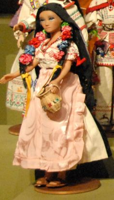 The Purepecha people of Mexico live in the state of Michoacan.  This doll from the Zuno de Echeverria collection of Mexican costume dolls represents a Purepecha woman.  Purepecha women often decorate their hair with ribbons and bows for festive occasions.   I don't know which community this doll is supposed to represent