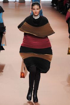 Issey Miyake | Fall 2014 Ready-to-Wear Collection | Style.com.....It looks like she's wearing a sleeping bag!!!! lol