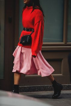 Hottest colours combination - Pink and red can seem too close for comfort, but set against polished black accessories, they'll enliven any grey pavement.