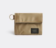'Gold t' wallet by Porter-Yoshida & Co. This classic wallet combines flawless Japanese design and premium technical fabrics, making it both versatile and beautiful in equal measure. This limited 'Gold T' edition is part of an exclusive collection celebrating 80 years of Porter. It is crafted from a gold nylon twill in a sateen finish. It has a generous main compartment for banknotes and cards with a zipped outer pocket for coins. Made in Japan. Shop it now at www.store.wallpaper.com