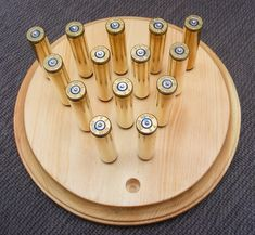A super easy project to make. This is like the puzzle game you find at Cracker Barrel, only I used spent rifle shells. Click the image to view the free tutorial. Woodworking Projects That Sell, Diy Wood Projects, Easy Projects, Woodworking Crafts, Wood Crafts, Woodworking Plans, Project Ideas, Woodworking Classes, Diy Crafts