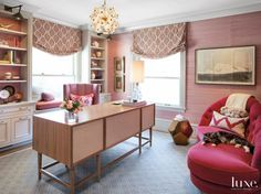 The wife's office showcases layers of pink, including the Phillip Jeffries wallcovering and window shades made with a Galbraith & Paul fabric from De Sousa Hughes. A Marbello Design wing chair pulls up to a desk from The New Traditionalists in New York.  Style On Picture Lifestyle