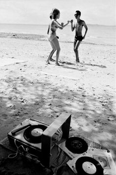 Who needs iPod docks when you could dance on a beach with a record player