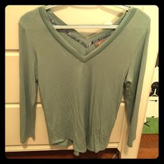 Free People shirt! with a v-neck in both the front and the back, this sea green shirt is sure to impress! Super soft and stretchy material, never used and in perfect condition! Free People Tops Tees - Long Sleeve