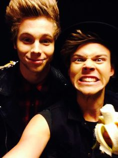 What is with these people and bananas?! and Luke, dear, your quiff is so high it barely fits in the photo...