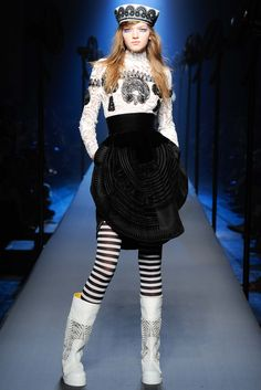 I guarantee you fashion eds will describe these boots (and the top, and the hat) as crocheted, but it's guipure lace. Repeat after me: Just because it's white and meshy doesn't mean it's crocheted! (Jean Paul Gaultier Fall 2015 Couture)