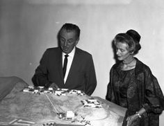 Walt Disney and the Los Angeles Conservatory of Music leader Mrs. Richard R. Von Hagen with an early model of California Institute of the Arts, 1964.   Although Chouinard Art Institute had continued to be highly regarded, by this time it had suffered with years of administrative problems, and in 1961 Walt and Roy O. Disney began to guide a merger of Chouinard with the venerable Los Angeles Conservatory of Music to form California Institute of the Arts.