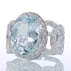 Diamond Aquamarine Ring. via Etsy. Love these designers. Husband and wife team who are a dream to work with.