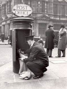 £2.50 - Greetings card - Postman clearing a pillar box in 1935. Available from http://www.postalheritage.org.uk/page/greetings-postmanpillar