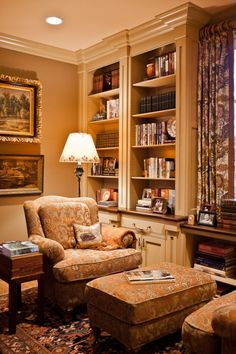 This is so warm, beautiful, and calming. I like the intimate seating grouping- notice how one ottoman can work for both people. The bookcases & art are very nice too.