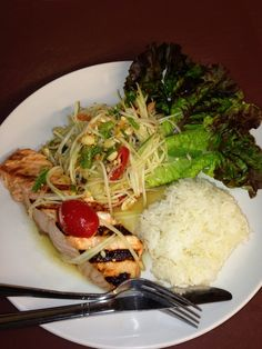 Chef Ginger's Grilled Salmon with Papaya Salad and Sticky Rice.