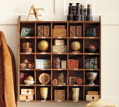 wood cubby organizer from pottery barn...could probably find a way to make this, or find someone who can ;]
