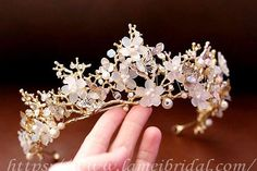 This sweet and simple elegant crown is made from tiny golden branches that are hand wrapped with golden ribbon on to a vine wire frame. The frame is strong but flexible, so you can move it and get a perfect and comfortable fit! The little leaves are made of plastic, so they will never crumble or break. The are very realistic looking and look like metal until you actually touch them. The ends tie together in the back with a long thin golden ribbon. Fully adjustable and will fit both a male…