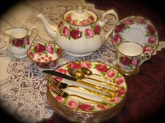 """Royal Albert's """"Old English Rose"""" lunch/salad service w/decorated rose sugar cubes and gold floral plated flatware.  Just sweet as can be. {I have this set}"""