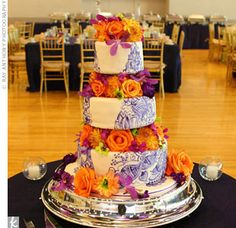 Henna style detailing covered the three-layered cake, while orange, purple and green blooms topped each layer. Orange Purple Wedding, Purple Wedding Cakes, Orange And Purple, Red Wedding, Wedding Stuff, Wedding Flowers, Purple Table, Orange Table, Wedding Desserts