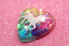 Unicorns & Rainbows Necklace... sparkly heart resin glitter pendant necklace with pink chain included by isewcute. $18.50, via Etsy.